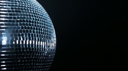 Half of Disco mirror ball on black backround