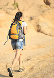 woman hiker walking on mountain trail