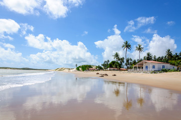 Beach with sand dunes and house, Pititinga, Natal (Brazil)