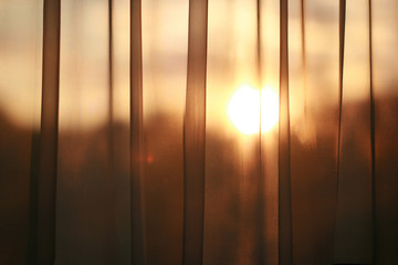 Curtain with sun