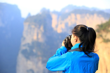 woman tourist taking photo at zhangjiajie,china