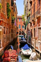 Picturesque canal in a quite neighborhood in Venice, Italy