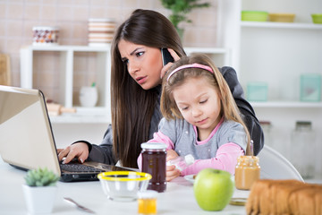 Overworked Businesswoman and her little daughter