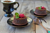 Chocolate fondant lava cake with raspberries and mint