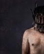 naked man with helmet made of forks