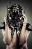 Man with helmet made ​​with forks and knives, artistic conce