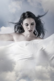 Environment, Beautiful woman in clouds, mithology concept. Brune