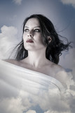 Skincare, Beautiful woman in clouds, mithology concept. Brunette