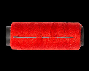 red thread on black background. macro