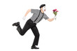 Excited mime artist running with a bouquet of flowers