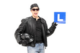 Biker holding an L sign