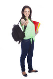 Full body portrait of female student giving thumbs up, isolated