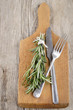 fork and knife with rosemary