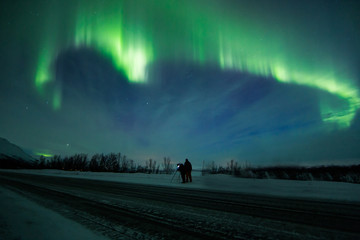 Northern lights (Aurora borealis) above road