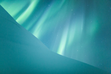 Northern lights (Aurora borealis) above snow