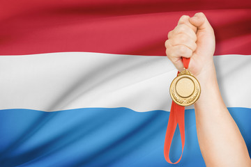 Medal in hand with flag - Grand Duchy of Luxembourg