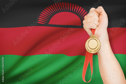 Medal in hand with flag on background - Republic of Malawi