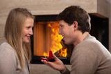 Proposing by fireplace