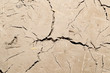 abstract background of cracked clay wall