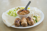vietnamese cuisine , roasted pork served with spicy sauce and ve