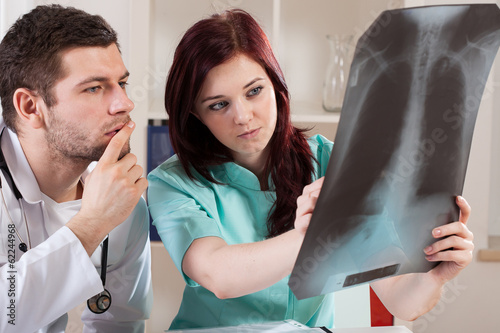 Doctor and nurse viewing X-ray