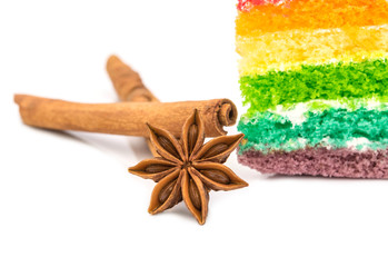 Star anise with rainbow cake  isolated on white background