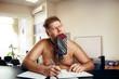 Freak naked businessman works in office