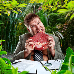 Predator businessman eating raw meat in jungles