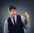 Small carrot in hands of a businessman