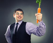 Carrot in hand of happy man