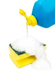 dishwashing liquid bottle and sponge covered with foam