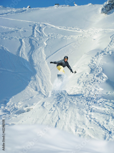Snowboarding. Mountain-skier jumps. A lot of copyspace