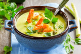 Cream of asparagus soup with shrimp.