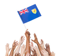 Human Hand Holding Turks and Caicos Islands Flag