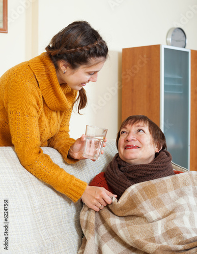 Adult daughter caring for unwell mother