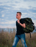 Man with backpack in nature
