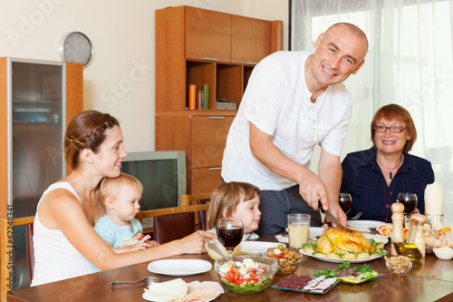 happy family together over dining table