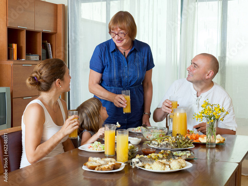 Portrait of happy multigeneration family communicate over health