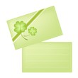Green Greeting Card with Four Leaf Clovers