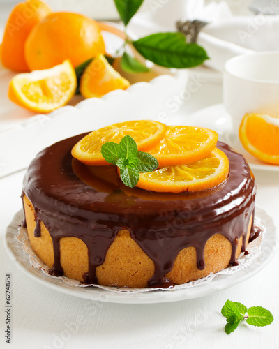 Orange cake with chocolate and orange slices.
