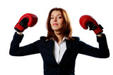 Businesswoman wearing boxing gloves standing