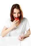Woman eating fresh strawberry cake