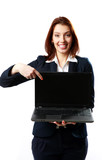 businesswoman holding laptop and pointing on it
