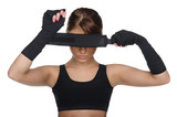 Woman covering her eyes boxing bandages