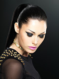 Beautiful face of fashion woman with bright makeup.