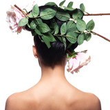 Rear view portrait of the woman with pink flowers in hair