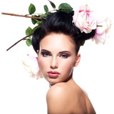 Beautiful young woman with flowers in hair.