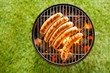 Beef bratwurst grilling over a barbecue fire - 62251127