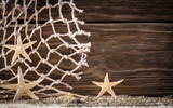 Nautical background with starfish and fishing net