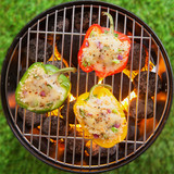 Grilling stuffed savory bell peppers on the BBQ